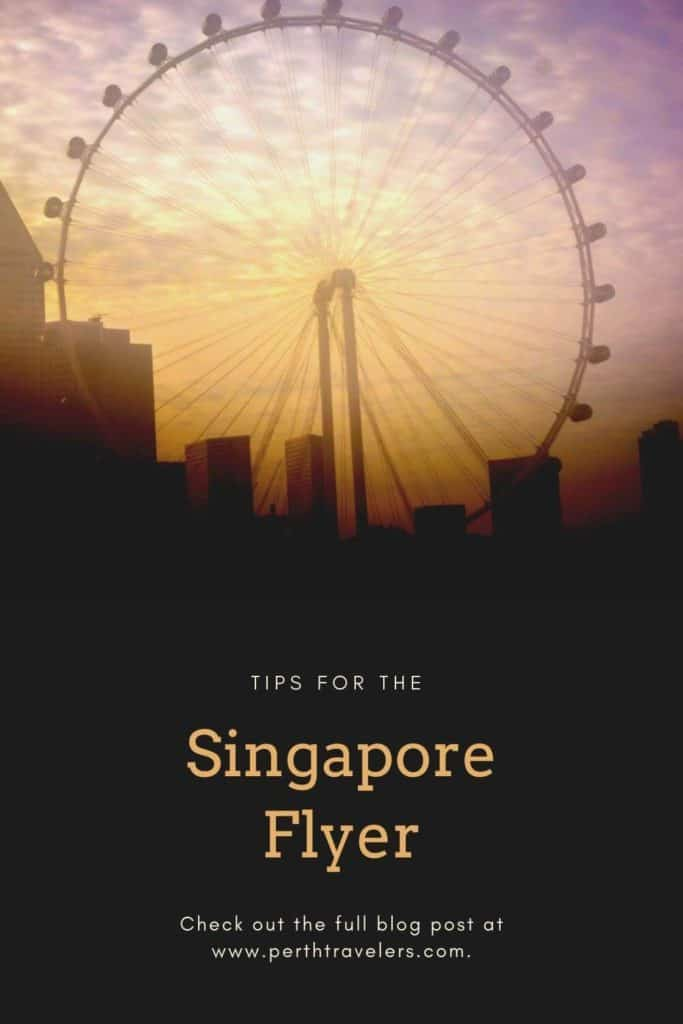 a large ferris wheel at sunset with words singapore flyer