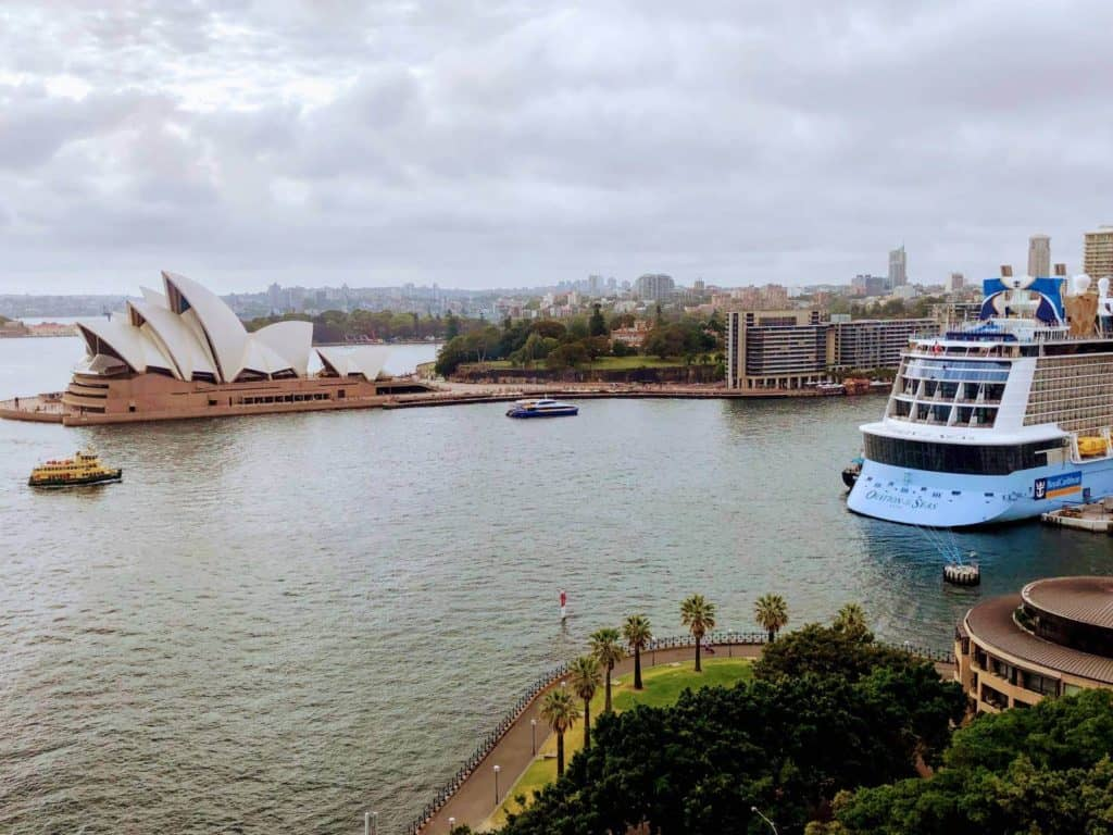 view of ferries and a cruise ship in a harbour with the sydney opera house