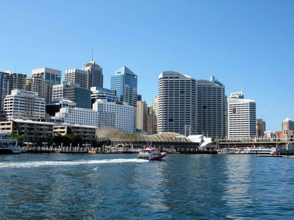 a city harbour with restaurants and tall buildings