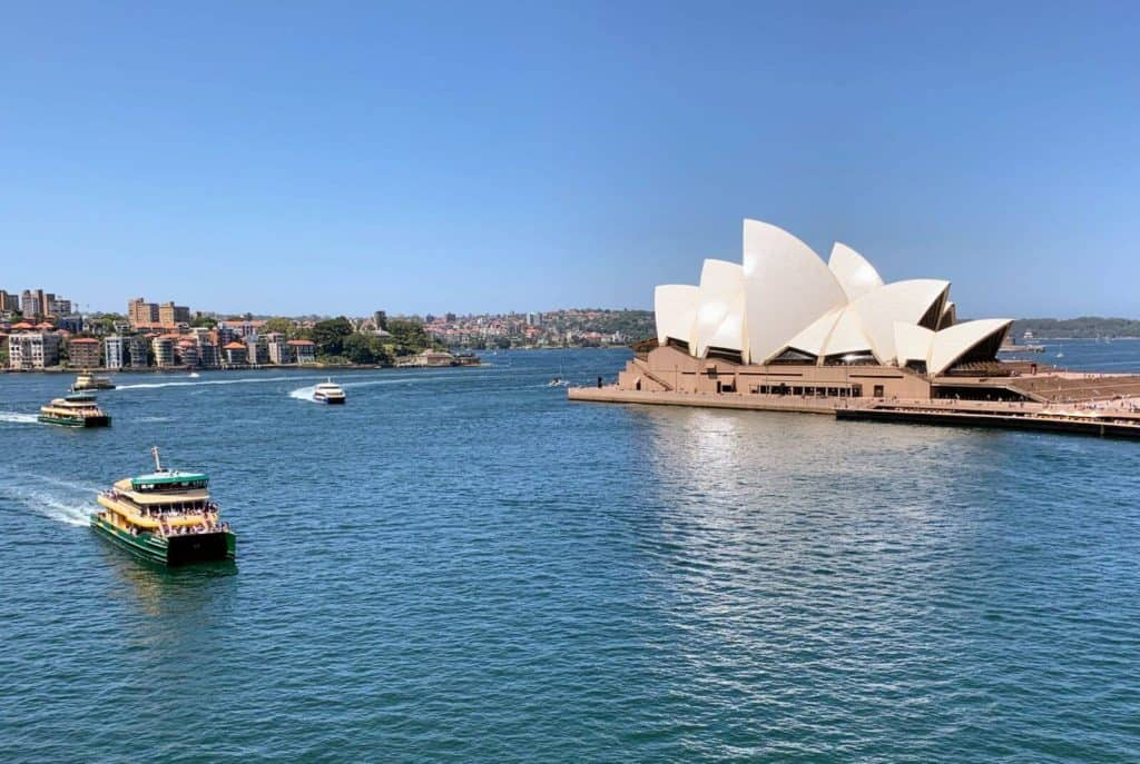 ferries in front of the sydney opera house new south wales