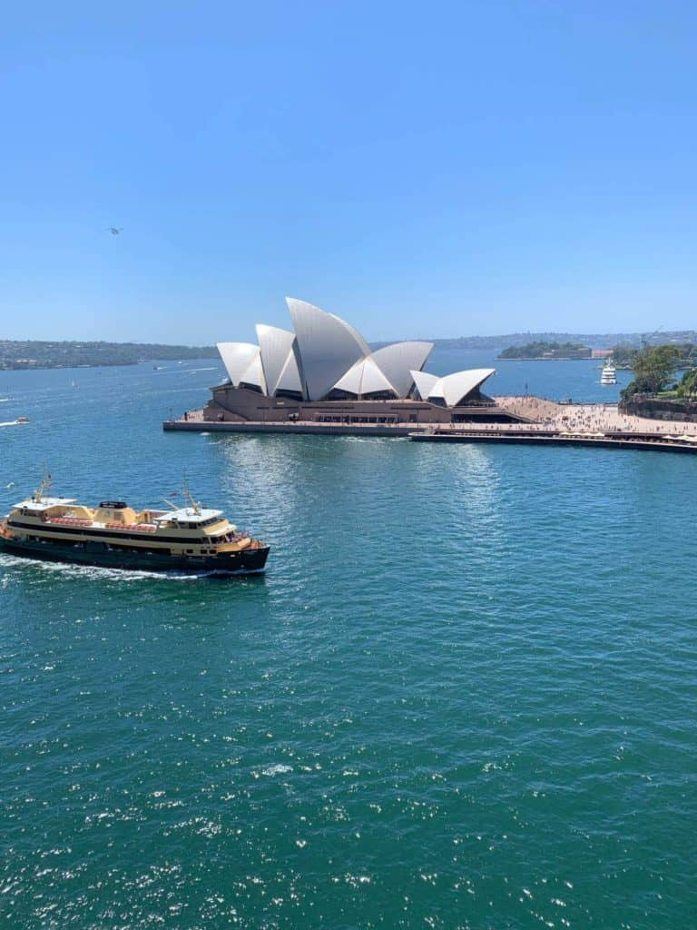 an aerial view of the sydney opera house with a ferry in front of it