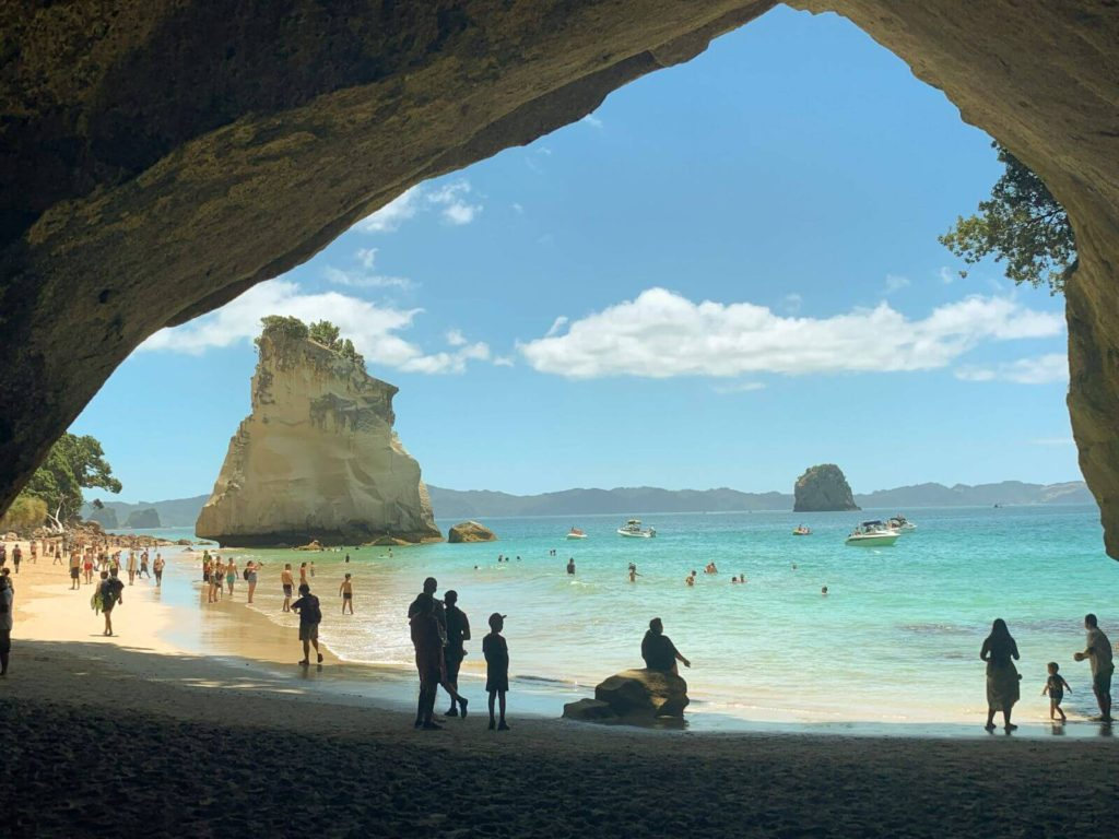 limestone arch on beach leading through to a stack in the ocean