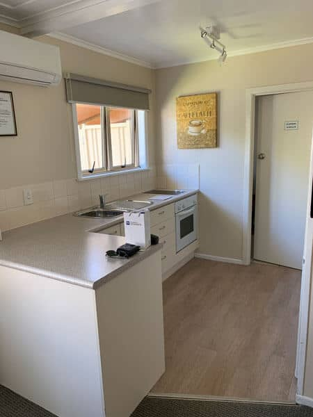 best western rotorua kitchen with oven sink and window