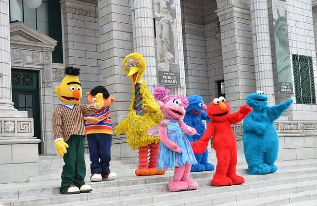 sesame street characters standing on steps at universal studios singapore one of the things to do in sentosa island