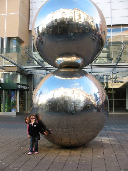 two stainless steel spheres in city shopping mall
