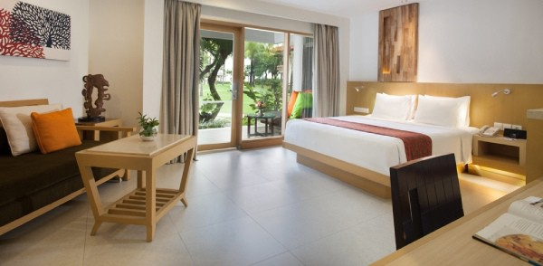 king bed hotel room with garden access