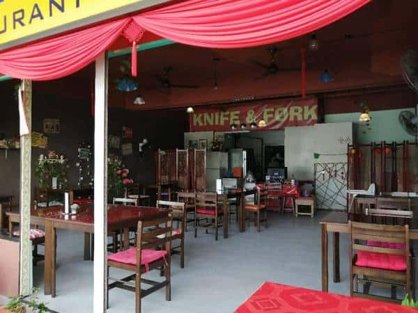 knife and fork restaurant with table and chairs