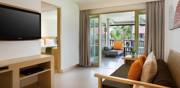 hotel suite with bedroom and lounge area