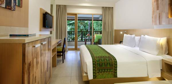 hotel room with king bed tv balcony overlooking tropical gardens