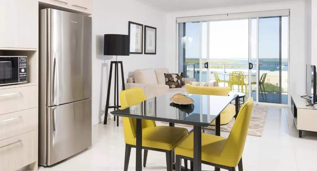 an apartment interior with kitchen and lounge