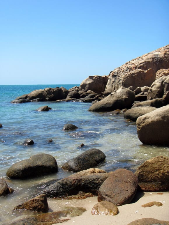 a rocky bay with clear ocean