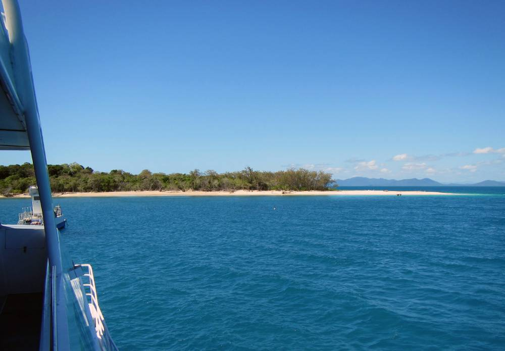 view of a tropical island from a boat with a semi submersible
